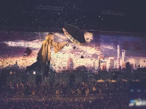 Cara Delevingne soars above the audience in a spectacular finale at the Burberry event in Shanghai - Executive Salad