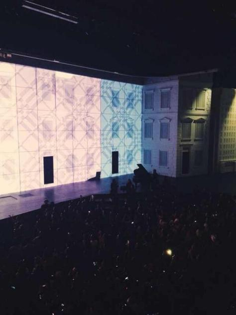 Vivid patterns, colours and textures are projected around the stage at the Burberry event in Shanghai - Executive Salad