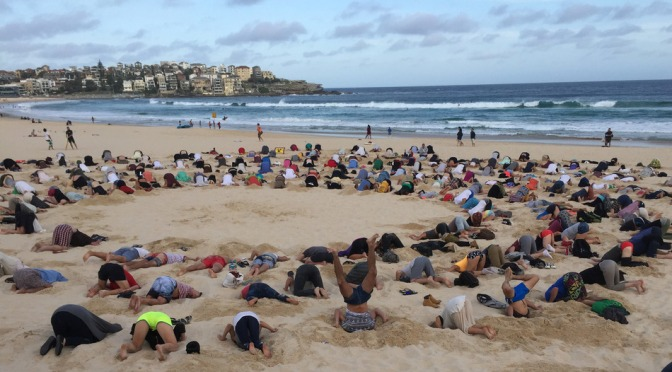 Australians put heads in the sand for Bondi Beach protest